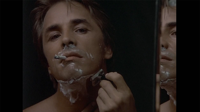 Of course he shaves with a razor-razor, smoking his unfiltered cigs