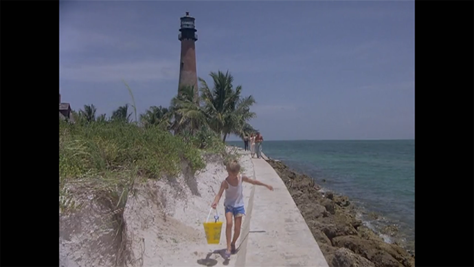 This is apparently the Cape Florida Lighthouse at Bill Baggs State Park on Key Biscayne: post card