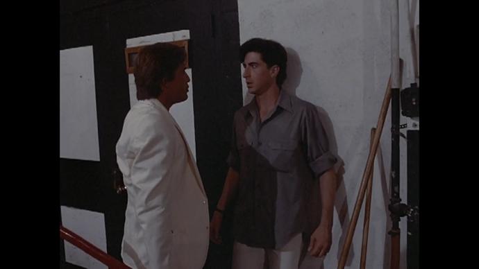 Crockett is holding a g-d fireaxe