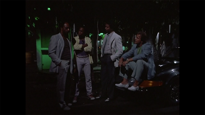 I LOVE that Crockett is just sitting on his fancy car like a hick, bless him