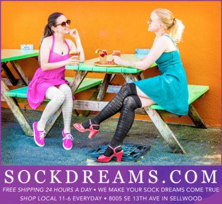 The upper area is a photo of two folks sitting at a bright picnic table, wearing vibrant summer dresses. One is wearing cute crew socks, the other is wearing openwork tights. The bottom half has ad copy about Sock Dreams.