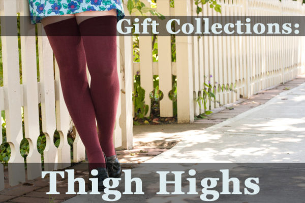 """Image of someone wearing dark red thigh highs, leaning against a white picket fence, in warm sunshine. The text over the image reads """"Gift Collections: Thigh Highs"""""""